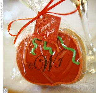 Individually wrapped pumpkin-shaped cookies served as favors. The couple's monogram lent a touch of elegance to the sweet treats, while tags with their names and wedding date completed the look.