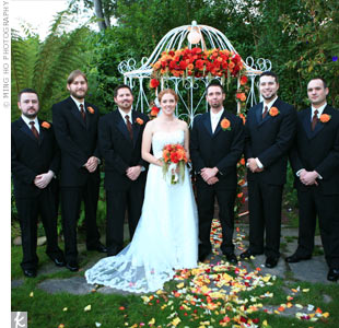 The guys wore classic black tuxedos. Jesse stood out with ivory accessories and a dahlia boutonniere with berry and twig accents. The groomsmen wore chocolate-brown vests and ties to match the bridesmaid dresses.