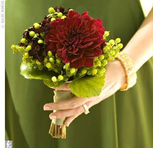 A big, bold dahlia was the main attraction in the bouquets. Chocolate cosmos and hypericum berries filled them out.