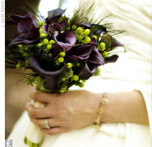 Peacock feathers added subtle drama to Elisa's calla lily and hypericum berry bouquet.