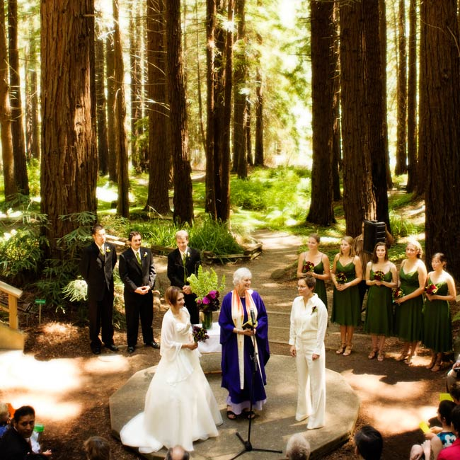 Towering redwood trees surrounded the amphitheater in the aptly-named Redwood Grove where the ceremony took place. Elisa and Michelle got married on a raised platform in the center marked by a simple arrangement of purple artichokes and dahlias and green bells of Ireland and bear grass.