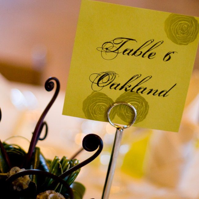 Echoing the look of the escort cards, the table cards featured names of places that were significant to the couple.