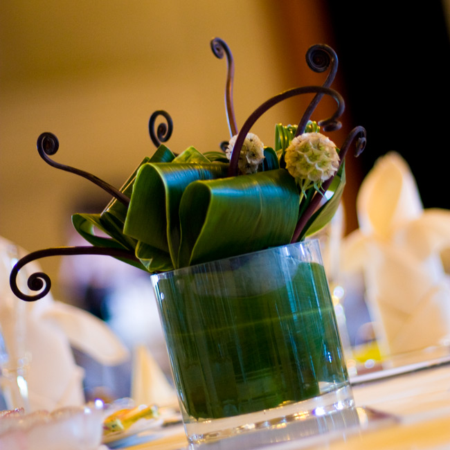 For a more organic vibe, aspidistra leaves dominated the table arrangements instead of flowers. Scabiosas and fiddlehead ferns gave each centerpiece a unique shape.