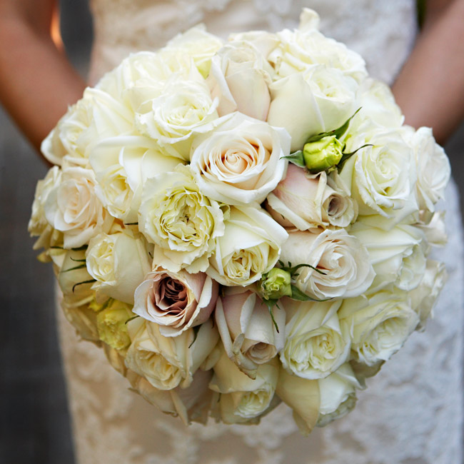 To mimic the look of peonies, the bride's flower of choice that's not available in August, the florist used cabbage roses mixed with other soft-colored roses.
