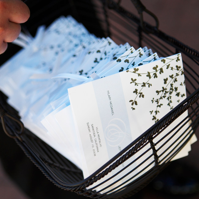 Shadowy cherry blossoms and a pale blue ribbon decorated the four-page ceremony booklets. The couple gave their guests an intimate look at their relationship by including letters they wrote to each other.