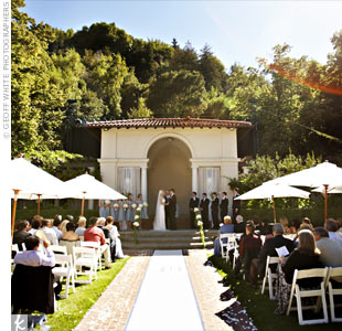 Umbrellas shaded guests from the summer sun in the Oval Garden at Villa Montalvo. A fixture at the site provided the perfect altar.