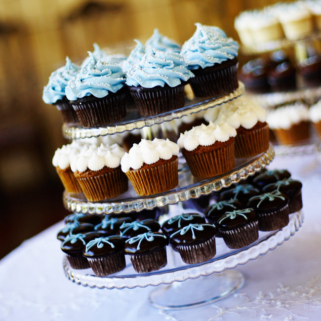 To keep up the lighthearted mood of the event, guests enjoyed cupcakes in the couple's signature colors. The tiered stands of colorful treats were as tempting as any cake.