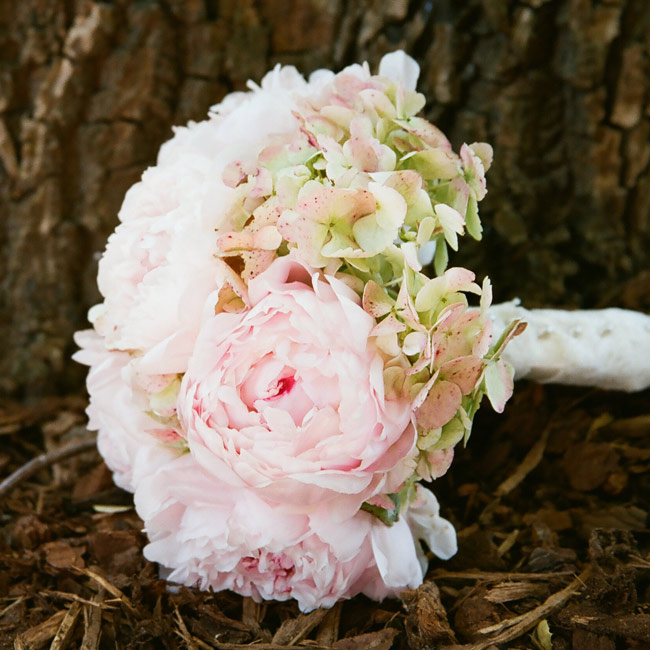 Kiki chose to focus on peonies, which represent bliss and prosperity in the Chinese culture, in her bouquet. Green hydrangeas mixed with the billowy blooms for added texture.