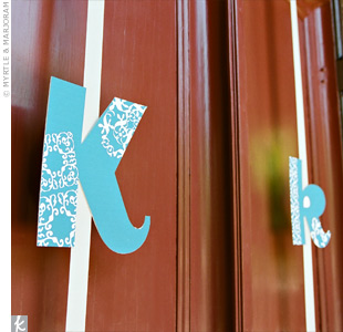 To decorate the church doors, Kiki designed a monogram in the color palette.
