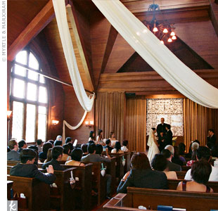 Instead of hiring a pro, Kiki and Hadi decorated the Sausalito Presbyterian Church themselves. They hung fabric from the ceiling and fastened hearts with teal or white ribbon along the aisle. To further personalize their ceremony, the couple wrote their own vows.