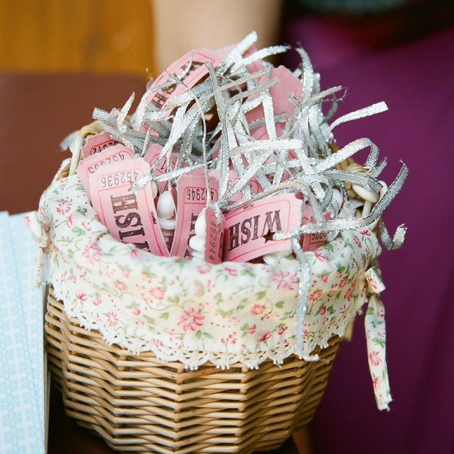 "As the newlyweds exited the church after the ceremony, guests blew bubbles. To shower the couple with good wishes, Kiki tied a ""wish ticket"" to each bottle of bubbles. ""I thought it would be a fun and warm way to throw us lots of blessings,"" says Kiki."