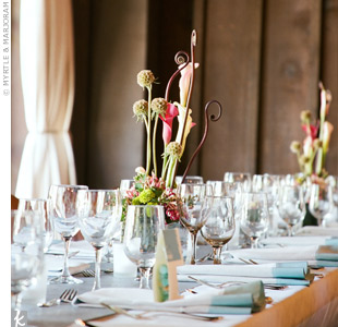 Since white and blue flowers are considered bad luck for Chinese weddings, exotic blooms in shades of pink and green were used to decorate the long, Tuscan-style reception tables.