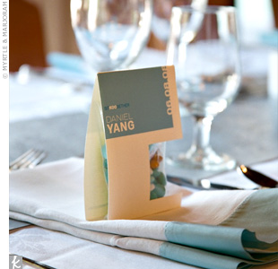 Custom-made bags, which Kiki and Hadi designed, were filled with teal and white M&Ms and did double duty as favors. Each was printed with guests' names and the wedding date and placed at table settings.