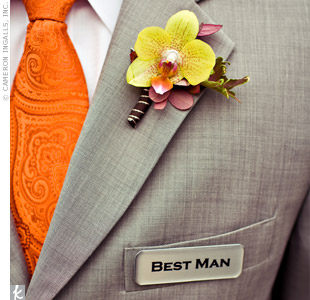 "The guys looked stylish in grey suits accented with orange ties for the groomsmen and a yellow one for the groom. They attached printed pins saying, ""groom,"" ""best man"" or ""groomsman"" to their jacket pockets."
