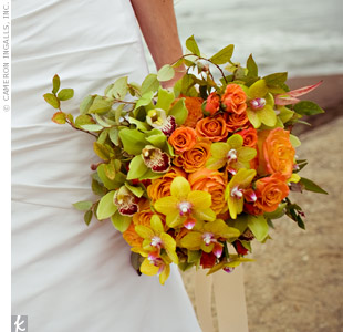 Orchids and roses in shades of gold, green and orange were vibrant and fun.
