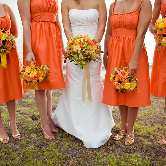 Chocolate cosmos distinguished the bridesmaids' bouquets from the bride's, and orange and yellow polka-dot ribbon wrapped the stems.