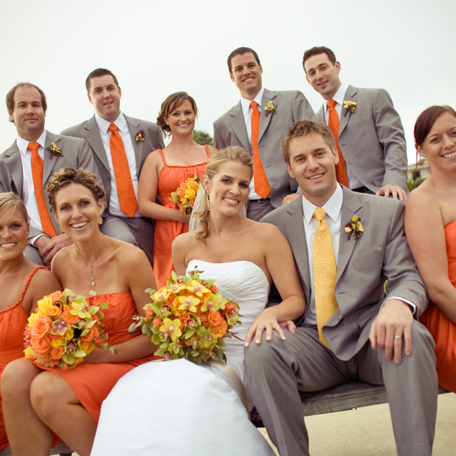 The groomsmen's ties perfectly matched the bridesmaids' orange ensembles.