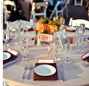 Chocolate brown napkins and orange-and-yellow centerpieces decorated the tables for a simple, stylish look.