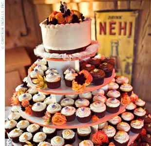Two hundred and fifty cupcakes lined a five-tier stand painted by the groom's mother.