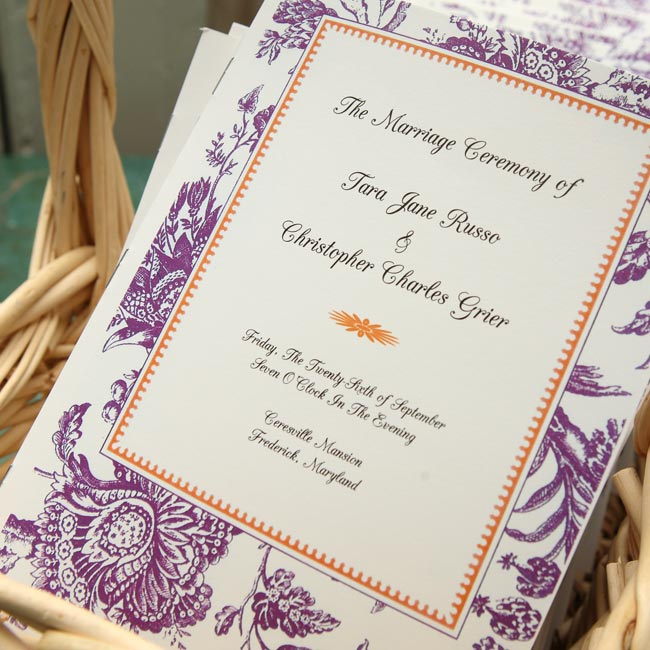 The groom's mother made the ceremony programs. The colors fit the purple-and-orange scheme and the toile print echoed the pastoral vibe of the venue.