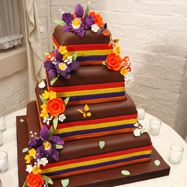 A stray from tradition, the couple went with a chocolate-colored wedding cake with playful fondant ribbon and sugar flower and butterfly accents.