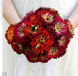 Crystal's bouquet of zinnias was a last-minute change from the red anemones she originally wanted. Their season ended just two weeks before the wedding! These flowers still conveyed the rich, rustic look Crystal was going for.