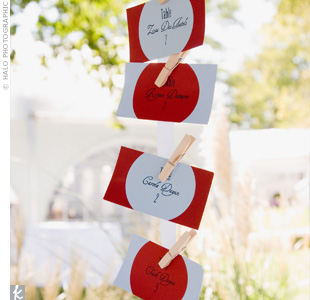 The bride and groom turned to TheKnot.com for their escort card inspiration. They attached their homemade cards to ribbons by clothespins, and then strung them from the gazebo to blow freely in the breeze.