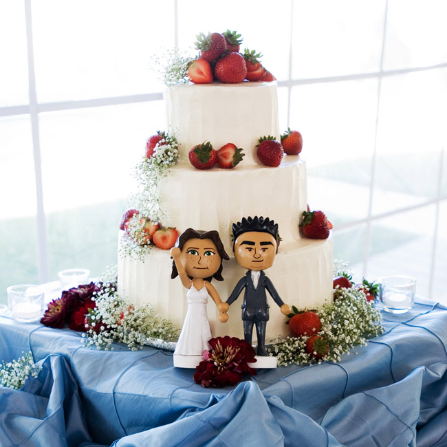 Strawberries topped the tiers of the buttercream-frosted cake instead of the heavy cake toppers. They were modeled after the couple's Miis, their avatars on their Nintendo Wii video game system.