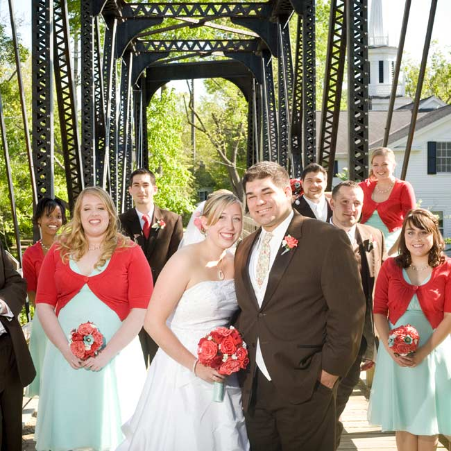 Short-sleeved sweaters (a gift from the bride) added a pop of color to the bridesmaids' aqua-hued dresses. The groomsmen mixed things up in chocolate-colored tuxedos with red-and-aqua patterned ties.