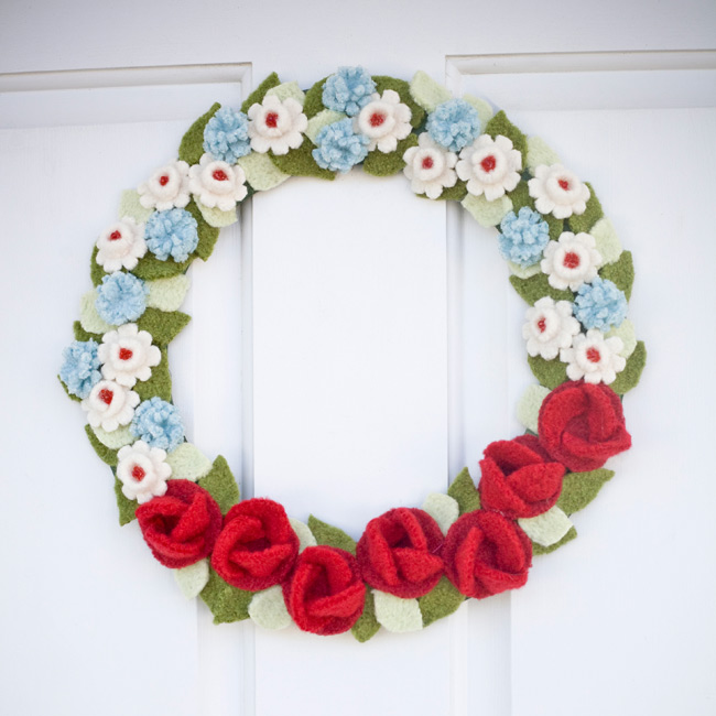 Using felt, the crafty couple created a floral wreath (without a single flower!), which they hung on the church doors.