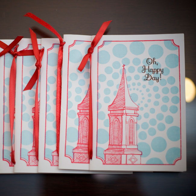 "A polka-dot background gave the church steeple on the programs a playful backdrop. Along with the ceremony lineup, the programs included a crossword puzzle with questions about the couple. ""We said that the puzzle was meant for early-comers and shouldn't be done during the ceremony!"""