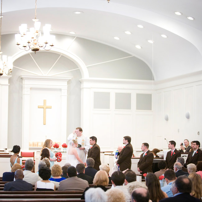Robin and Danny exchanged personalized vows during an afternoon ceremony. The couple loved the light and airy look of the sanctuary, so little decor was needed save for Mason jars filled with paper flowers at the altar.