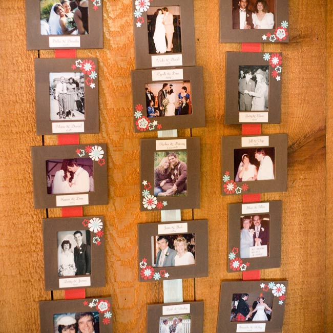 At the entrance to the reception site, the couple hung a display of their relatives' wedding photos. Each picture was placed in chocolate-brown frame decorated with red and aqua flowers, and hung on the wall from wide ribbon.