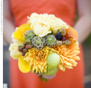 The bridesmaids carried bouquets made up of yellow and orange calla lilies, dahlias, and roses accented with berries.