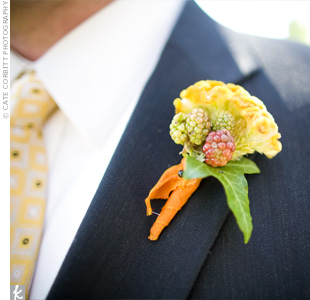 Wayne's groomsmen wore boutonnieres of cockscomb accented with berries.