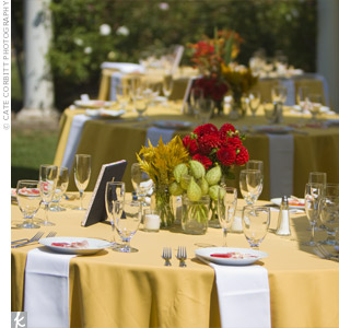 Yellow linens covered the reception tables, adding to the fun, colorful feel of the outdoor wedding.