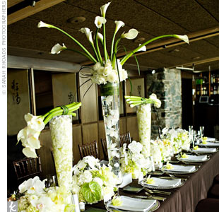 The family-style banquet table was decorated with large floral centerpieces and a row of arrangements composed of cymbidium and phalaenopsis orchids, calla lilies, and anthurium, with accents of roses and hydrangeas. The chocolate-brown linens contrasted beautifully with the vibrant green and white details.