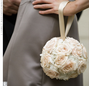 The bridesmaid bouquets were pomanders of pale pink roses.