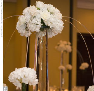 White hydrangeas in tall, glass vases sat on all the reception tables. Small votive candles added a nice glow to the room.