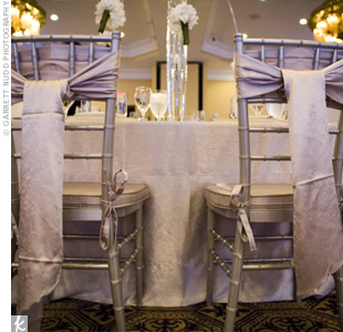 Long bows tied to the backs of the reception chairs added a romantic feel to the reception space.