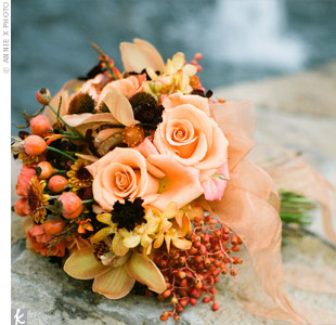 The bridesmaids carried rounded bouquets similar to Melanie's. Open roses, orchids, echinacea pods, montbretia, berries, and ranunculus in shades of shades of orange, tangerine, apricot, copper, and chocolate were wrapped with copper organza ribbon.