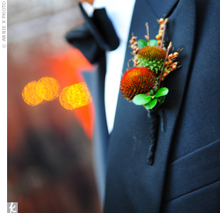 The nine groomsmen, the fathers of the bride and groom, and Melanie's godfather (the ceremony officiate) wore boutonnieres made of copper-colored echinacea pods, twigs, and tiny orange berries.