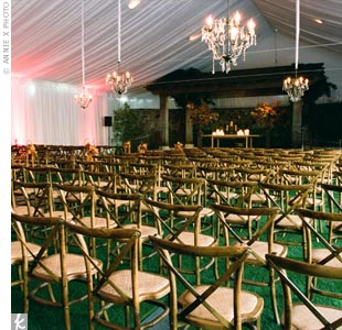 When rain threatened Melanie and Drew's plans for an outdoor ceremony, the ceremony chairs were quickly moved under part of the dining tent. The tent provider was able to hide the dining area with copper draping.