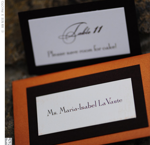 For the escort cards, Melanies mother bought tiny copper-colored envelopes on clearance at an art supply store. She also found textured brown card stock to match the invitations, which she gave to the printer.