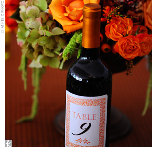 In honor of wine country, bottles of a local Merlot served as Melanie and Drew's table numbers. The original labels were soak-removed from the bottles and replaced with custom-printed ones.