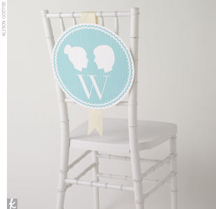 Spin your monogram in a clever way: Hang it over chair backs with your silhouettes. Download this template at TheKnot.com/DIYchair.