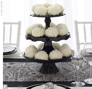 Black is white's most dramatic accessory. Add texture to a solid white tablecloth with an unexpected layering technique. Also think about doubling up: Work a modern, graphic fabric with a solid black runner. Then complete the picture with coordinating napkins to match.