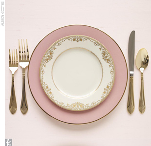 Pair larger pale pink plates for the main course with salad plates with delicate gold detailing for an elegantly understated combination.