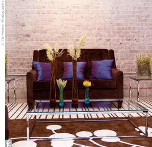 Plush furniture, colorful accent pillows, and graphic rugs created a comfortable and stylish space for networking.
