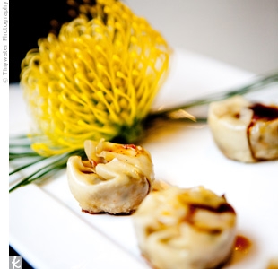 Guests sampled a variety of gourmet bites at the party, including savory potstickers.